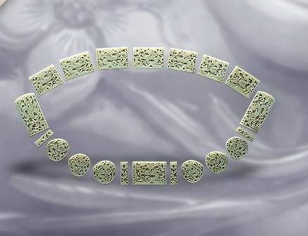 玉鱼龙花草纹带饰--明